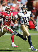 SAN FRANCISCO - SEPTEMBER 17:  Wide receiver Torry Holt #81 of the St. Louis Rams goes deep for a pass while defended by cornerback Walt Harris #27 of the San Francisco 49ers at Monster Park on September 17, 2006 in San Francisco, California. The Niners defeated the Rams 20-13. ©Paul Anthony Spinelli *** Local Caption *** Torry Holt;Walt Harris