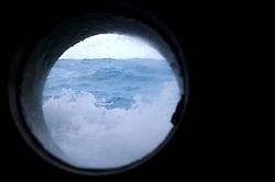 ATLANTIC OCEAN ABOARD ARCTIC SUNRISE 12MAY11 - Waves wash into a porthole of the Greenpeace ship Arctic Sunrise in the North Atlantic.........Photo by Jiri Rezac / Greenpeace