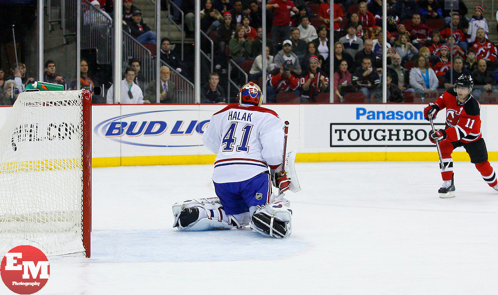 Jan 2, 2009; Newark, NJ, USA; New Jersey Devils center John Madden (11) shoots and scores past Montreal Canadiens goalie Jaroslav Halak (41) during the second period at the Prudential Center.