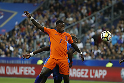 France's Paul Pogba battling Netherlands's Quincy Promes during the World Cup 2018 Group A qualifications soccer match, France vs Netherlands at Stade de France in Saint-Denis, suburb of Paris, France on August 31st, 2017 France won 4-0. Photo by Henri Szwarc/ABACAPRESS.COM