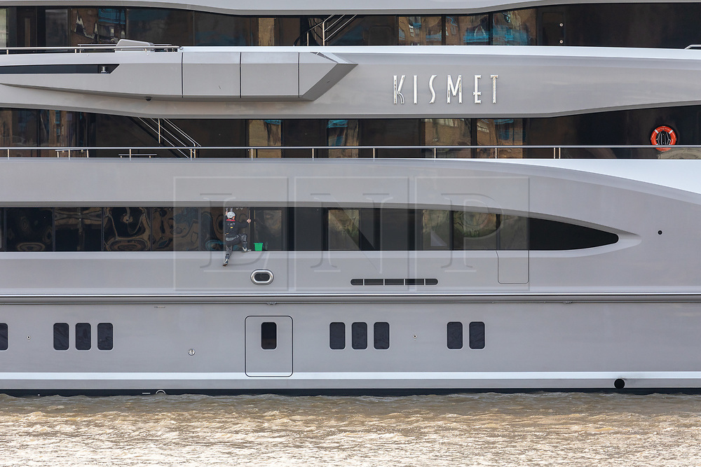 © Licensed to London News Pictures. 30/10/2019. London, UK.  A person washes windows on the 308 feet long luxury superyacht, Kismet owned by Pakistani American billionaire businessman, Shahid Khan is seen moored at Butlers Wharf near Tower Bridge on the River Thames. Shahid Khan owns the National Football League (NFL) team, the Jacksonville Jaguars, who are due to play the Houston Texans in an International Series game at Wembley this Sunday. Kismet has 6 staterooms, with the master bedroom having its own private deck with jacuzzi and helipad and can be chartered for an estimated £1m per week.Photo credit: Vickie Flores/LNP