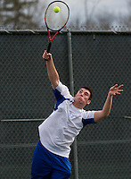 Interlakes Kaleb Phelps serves the ball to Prospect Mountain's Joey Cleary during during their singles match  on Friday afternoon in Meredith.   (Karen Bobotas/for the Laconia Daily Sun)