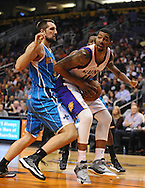 Nov. 23, 2012; Phoenix, AZ, USA; Phoenix Suns forward Markieff Morris (11) handles the ball during the game against the New Orleans Hornets forward Ryan Anderson (33) in the second half at US Airways Center. The Suns defeated the Hornets 111-108 in overtime. Mandatory Credit: Jennifer Stewart-US PRESSWIRE