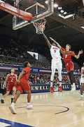 SMU Mustangs guard Emmanuel Bandoumel (5) drives for a layup while being guarded by Hartford Hawks forward Hunter Marks (0), PJ Henry (11) and D.J. Mitchell (2) during an NCAA college basketball game, Wednesday, Nov. 27, 2019, in Dallas.SMU defeated Hartford 90-58. (Wayne Gooden/Image of Sport)