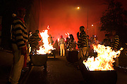 Late night parade on the streets of Lewes - bonfire society members pulling flaming  tar barrels around the streets. 5/11/05