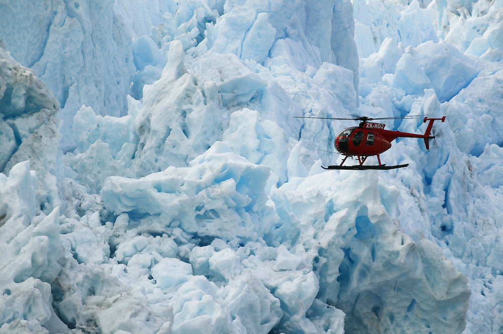 A Greenpeace helicopter flies past the terminus of the Pio XI glacier in the Southern Patagonian Icefield, Chile, Jan. 29, 2004. Daniel Beltra/Greenpeace.