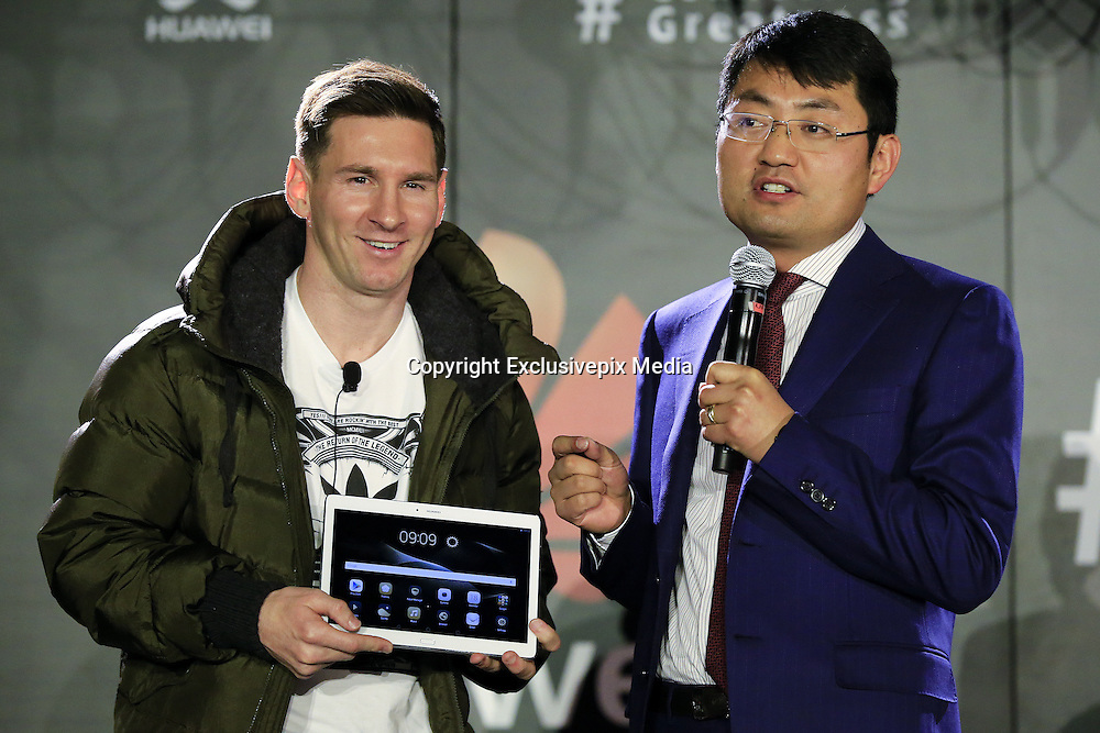 BARCELONA, March 18,  2016  <br /> <br /> FC Barcelona's Argentinian forward Lionel Messi and Walter Ji (R), President of Consumer Business Group of Huawei Western Europe, present the new Huawei tablet during a press conference in which Huawei announces Messi's appointment as the company's latest Global Brand Ambassador in Barcelona, Spain, March 17, 2016.<br /> ©Exclusivepix Media