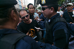 © Licensed to London News Pictures. 24/05/2014. An Anti-coup protestor clashes with police following a Anti-Coup protest in Bangkok Thailand. The Royal Thai army announced a Military coup and have imposed a 10pm curfew.  Photo credit : Asanka Brendon Ratnayake/LNP