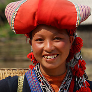 Phan Lo May, 24, of the Red Dzao ethnic minority group, near her village in the Highlands of Northern Vietnam close to the Chinese border. Northern Vietnam is inhabited by highland minorities including Hmong and Dzao groups who trade with tourists in Sapa. Sapa is now a thriving tourist destination for travelers taking the night train from Hanoi. Sapa, Vietnam. 16th March 2012. Photo Tim Clayton