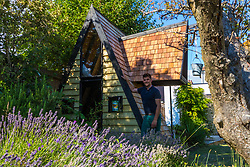 Dad of two Tom Prior has created a beautiful shingle clad, two floor play house in the garden of his Shoreham, West Sussex home for his children. Shoreham, West Sussex, July 15 2019.