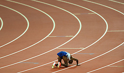 London, 2017-August-04. Mo Farah kisses the ground at the finish of the Men's 10,000m at the IAAF World Championships London 2017. ©Paul Davey.