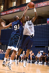 PF Wally Judge (Jacksonville, FL / Arlington Country Day) blocks a shot by C/F Cadarian Raines (Petersburg, VA / Petersburg). The NBA Player's Association held their annual Top 100 basketball camp at the John Paul Jones Arena on the Grounds of the University of Virginia in Charlottesville, VA on June 20, 2008