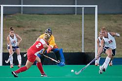 Virginia Cavaliers M/B Sara Confer (22) disrupts a Radford short corner.  ..The Virginia Cavaliers field hockey team faced the Radford Highlanders at the University Hall Turf Field in Charlottesville, VA on October 10, 2007.