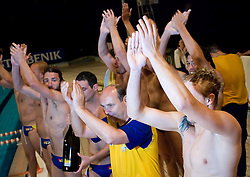 Players of Koper and coach Marino Cetin celebrate at last final game of Slovenian Waterpolo National Championship between ASD Rokava Koper and VK Triglav Kranj, on June 6, 2009, in Zusterna, Koper, Slovenia. Rokava Koper won 13:6 and became Slovenian National Champion for the season 2008/2009. (Photo by Vid Ponikvar / Sportida)