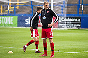 Morecambe defender Steven Old warming up before the EFL Sky Bet League 2 match between Macclesfield Town and Morecambe at Moss Rose, Macclesfield, United Kingdom on 20 August 2019.