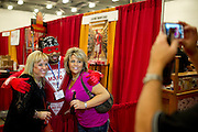 "Lori Hays and Lori Boyse pose with Commedian Grosfmann aka ""Hotter Than A MOFO Man"" during ZestFest at the Irving Convention Center on Saturday, January 26, 2013 in Irving, Texas. (Cooper Neill/The Dallas Morning News)"