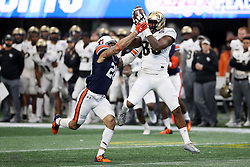 UCF Knights tight end Michael Colubiale (86) makes a catch over Auburn Tigers defensive back Tray Matthews (28) during the 2018 Chick-fil-A Peach Bowl NCAA football game on Monday, January 1, 2018 in Atlanta. (Jason Parkhurst / Abell Images for the Chick-fil-A Peach Bowl)