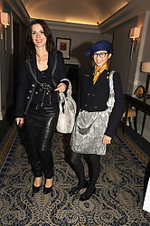 Left to right, Jewellery designer LARA BOHINC and HANNAH BHUIYA at the In Style Handbag Auction is association with Revlon raising money for the Rainbow Trust children's charity held at the Berkeley Hotel, Knightsbridge, London on 4th November 2008.