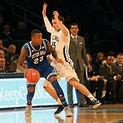 Fuquan Edwin, Seton Hall, is defended by Ryan Archidiacono, Villanova, during the Villanova Wildcats Vs Seton Hall Pirates basketball game during the Big East Conference Tournament at Madison Square Garden, New York, USA. 12th March 2014. Photo Tim Clayton