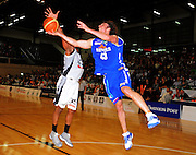 Saints forward Casey Frank tries to lay a shot up past Galen Young. NBL - Wellington Saints v Bay Hawks at TSB Bank Arena, Wellington, New Zealand on Friday, 3 June 2011. Photo: Dave Lintott / photosport.co.nz