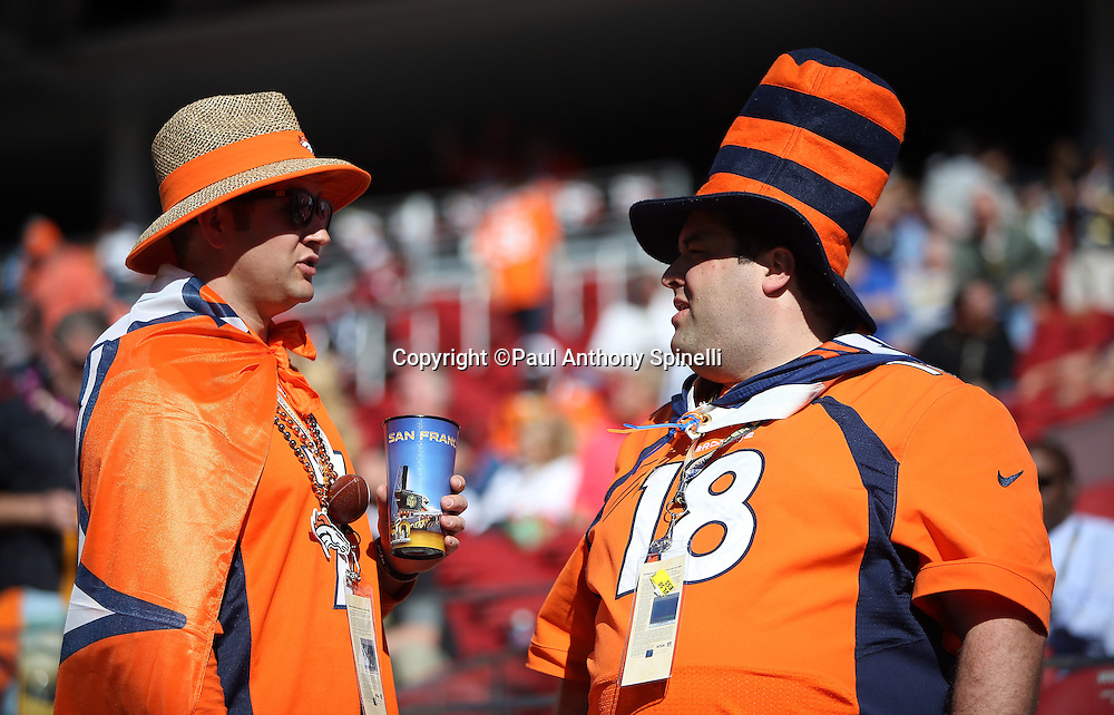 Denver Broncos fans wearing team gear and a cup bearing the name San Francisco have a conversation before the Denver Broncos NFL Super Bowl 50 football game against the Carolina Panthers on Sunday, Feb. 7, 2016 in Santa Clara, Calif. The Broncos won the game 24-10. (©Paul Anthony Spinelli)