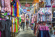 06 JUNE 2013 - BANGKOK, THAILAND:     Shoppers walk through Bobae Market in Bangkok. Bobae Market is a 30 year old market famous for fashion wholesale and is now very popular with exporters from around the world. Bobae Tower is next to the market and  advertises itself as having 1,300 stalls under one roof and claims to be the largest garment wholesale center in Thailand.       PHOTO BY JACK KURTZ