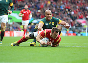Wales Gareth Davies scoring Wales's first try during the Rugby World Cup Quarter Final match between South Africa and Wales at Twickenham, Richmond, United Kingdom on 17 October 2015. Photo by Matthew Redman.