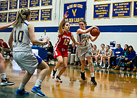 Laconia's Devon Mello keeps pressure on Gilford's Brooke Beaudet during the girls final at the holiday basketball tournament Friday evening.  (Karen Bobotas/for the Laconia Daily Sun)