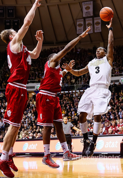 WEST LAFAYETTE, IN - JANUARY 30: Ronnie Johnson #3 of the Purdue Boilermakers shoots the ball against Remy Abell #23 of the Indiana Hoosiers at Mackey Arena on January 30, 2013 in West Lafayette, Indiana. (Photo by Michael Hickey/Getty Images) *** Local Caption *** Ronnie Johnson; Remy Abell