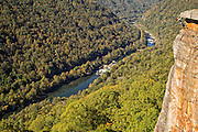 """Elaina Arenz climbing above the New River on """"Photo Finish"""" 5.9, at Beauty Mountain in the New River Gorge"""