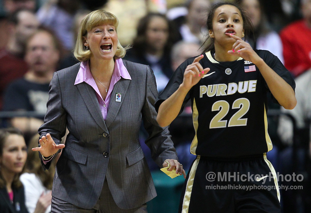March 03, 2012; Indianapolis, IN, USA; Purdue Boilermakers head coach Sharon Versyp and Purdue Boilermakers guard KK Houser (22) seen on the sidelines against the Penn State Lady Lions during the semifinals of the 2012 Big Ten Tournament at Bankers Life Fieldhouse. Purdue defeated Penn State 68-66. Mandatory credit: Michael Hickey-US PRESSWIRE