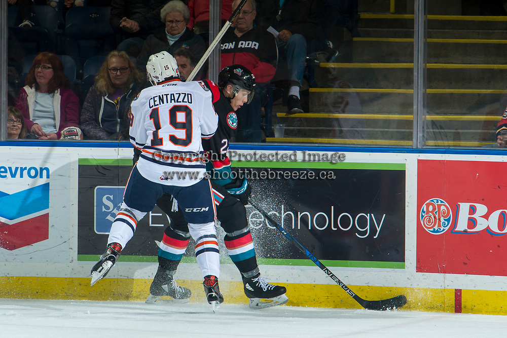 KELOWNA, CANADA - SEPTEMBER 22:  Orrin Centazzo #19 of the Kamloops Blazers checks Braydyn Chizen #22 of the Kelowna Rockets into the boards on September 22, 2018 at Prospera Place in Kelowna, British Columbia, Canada.  (Photo by Marissa Baecker/Shoot the Breeze)  *** Local Caption ***