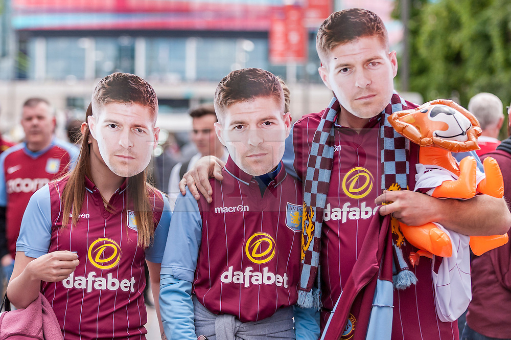 © Licensed to London News Pictures. 30/05/2015. London, UK. Aston Villa supporters wear a face-mask of Steven Gerrard (whose birthday it is today), as fans gather at Wembley Stadium for the FA Cup Final 2015, between Arsenal and Aston Villa. Photo credit : Stephen Chung/LNP