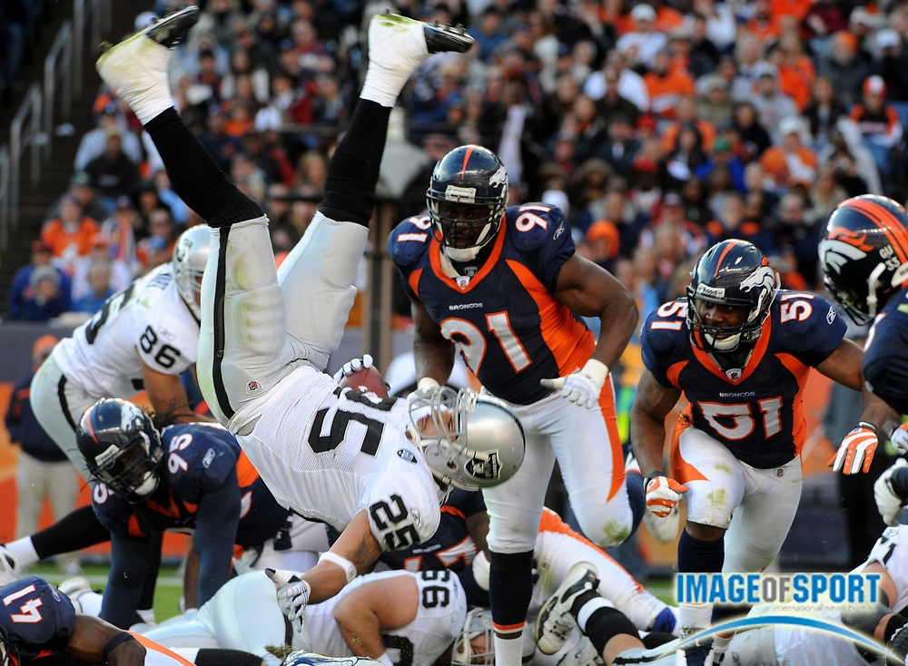 Nov 23, 2008; Denver, CO, USA; Oakland Raiders running back Justin Fargas (25) is upended at the goal line in the second quarter against the Denver Broncos at Invesco Field. The Raiders defeated the Broncos 31-10.