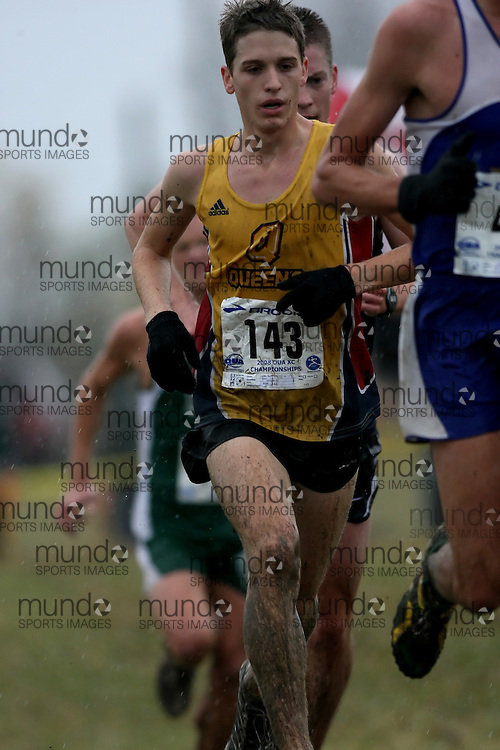 (Kingston, ON---25 October 2008) Josh Potvin of QUEEN'S University running to finish 23 in the 2008 Ontario University Athletics men's cross country championship.  Photograph copyright Sean Burges/Mundo Sport Images (www.msievents.com).