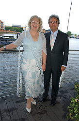 SIR CHRISTOPHER & LADY HOWES  at a party hosted by Sonia & Andrew Sinclair at The Westminster Boating Base, 136 Grosvenor Road, London SW1 on 5th June 2006.<br />