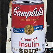 Art Campbell's Cream of Insulin Soup graffiti street art on side of street  side of building wall  in Manhattan.