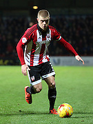 Brentford defender Jake Bidwell setting up an attack during the Sky Bet Championship match between Brentford and Middlesbrough at Griffin Park, London, England on 12 January 2016. Photo by Matthew Redman.