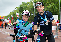 Father and daughter Jonathan and Naomi Perry celebrate completing the The Prudential RideLondon Pre-Surrey 19. Sunday 29th July 2018<br /> <br /> Photo: Andrew Baker for Prudential RideLondon<br /> <br /> Prudential RideLondon is the world's greatest festival of cycling, involving 100,000+ cyclists - from Olympic champions to a free family fun ride - riding in events over closed roads in London and Surrey over the weekend of 28th and 29th July 2018<br /> <br /> See www.PrudentialRideLondon.co.uk for more.<br /> <br /> For further information: media@londonmarathonevents.co.uk
