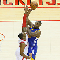 23 May 2015: Golden State Warriors center Festus Ezeli (31) goes for the jump shot over Houston Rockets forward Terrence Jones (6) during the Golden State Warriors 115-80 victory over the Houston Rockets, in game 3 of the Western Conference finals, at the Toyota Center, Houston, Texas, USA.