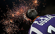 Andre-Pierre Gignac celebrates whilst watching the fireworks after the match which ended 0-0 and confirms that Toulouse will play in the Europa Cup next season after finishing fourth in the league. Toulouse v Lyon, 38eme Journee, France Ligue 1, Toulouse, France, 29th May 2009.
