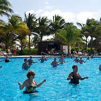 Resort guests at a water aerobics class.