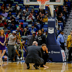 Feb 7, 2018; New Orleans, LA, USA; NBA official Josh Tiven inspects the court before a game between the New Orleans Pelicans and the Indiana Pacers was postponed after a nearly two hour delay due to a roof leak at the Smoothie King Center. Mandatory Credit: Derick E. Hingle-USA TODAY Sports