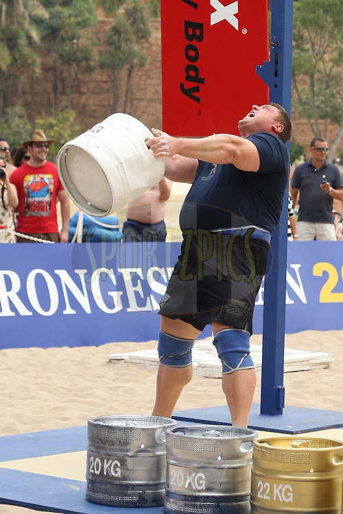 Defending champion Zydrunas Savickas (Lithuania) in the overhead keg-toss during the final rounds of the World's Strongest Man competition held in Sun City, South Africa.