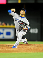 Sep. 27 2011; Phoenix, AZ, USA; Los Angeles Dodgers pitcher Hiroki Kuroda (18) delivers a pitch during the fifth inning against the Arizona Diamondbacks at Chase Field.  Mandatory Credit: Jennifer Stewart-US PRESSWIRE.