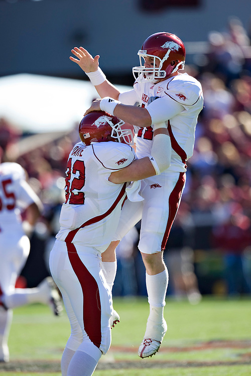 COLUMBIA, SC - NOVEMBER 8:   Casey Dick #11 and Andrew Davie #82 of the Arkansas Razorbacks celebrate after a touchdown during a game against the South Carolina Gamecocks at Williams-Brice Stadium on November 8, 2008 in Columbia, South Carolina.  South Carolina defeated the Razorbacks 34-21.  (Photo by Wesley Hitt/Getty Images) *** Local Caption *** Casey Dick; Andrew Davie