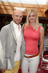 MATT DAWSON and CAROLIN HAUSKELLER at the Audi International Polo at Guards Polo Windsor Great Park, Egham, Surrey on 28th July 2013.