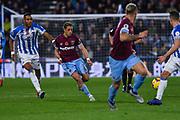 Javier Hernandez of West Ham United (17) passes the ball forward as. Mathias Zanka Jrrgensen of Huddersfield Town (25) chases him down during the Premier League match between Huddersfield Town and West Ham United at the John Smiths Stadium, Huddersfield, England on 10 November 2018.