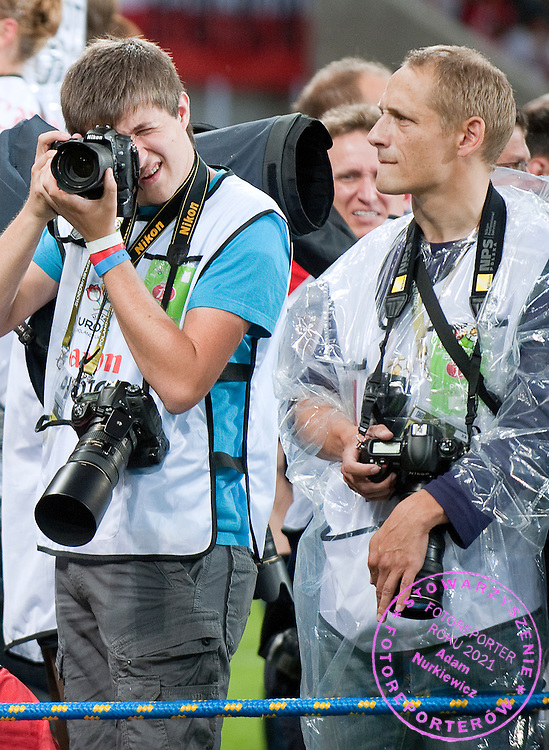 (R) Photographer Piotr Hawalej during the UEFA EURO 2012 Group A football match between Poland and Czech Republic at Municipal Stadium in Wroclaw on June 16, 2012...Poland, Wroclaw, June 16, 2012..Picture also available in RAW (NEF) or TIFF format on special request...For editorial use only. Any commercial or promotional use requires permission...Photo by © Adam Nurkiewicz / Mediasport