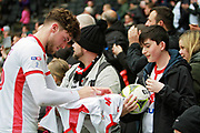 MK Dons Robbie Muirhead(16) signs shirts for the fans after the EFL Sky Bet League 1 match between Milton Keynes Dons and Scunthorpe United at stadium:mk, Milton Keynes, England on 28 April 2018. Picture by Nigel Cole.